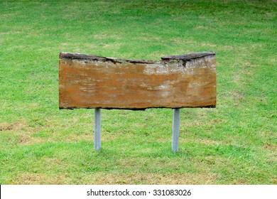 wooden sign in park or garden