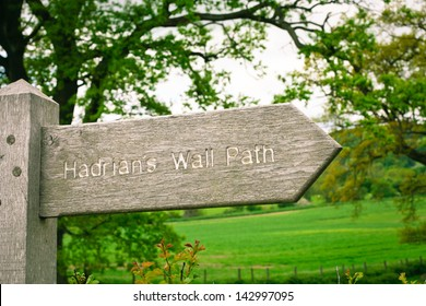 Wooden sign for part of the Hadrian's Wall Path in Northumberland, UK