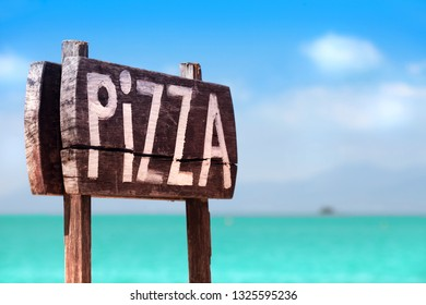 A Wooden Sign of Pizza, sea coas, sky, white clouds, close