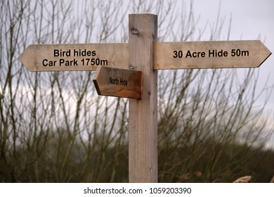 Wooden sign post on a country lane