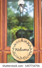 "Wooden sign reads ""Welcome"" on a wooden door in front of a coffee shop in vintage style"