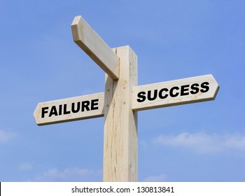 Wooden sign with the words SUCCESS and FAILURE