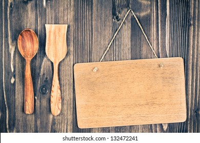 Wooden signboard hanging wall background, spoon, spatula