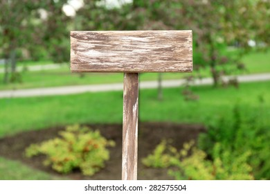 Wooden signboard on nature background
