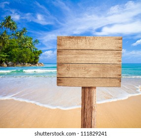 wooden signboard on tropical beach