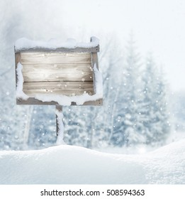 Wooden signboard in snow .Christmas banner.Merry christmas and happy new year greeting card with copy-space