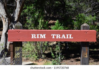 Wooden signpost about Rim Trail at Grand Canyon, Arizona