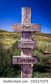 Wooden signpost with carved letters. Future, present, past. Life, sign, signpost, quote, message, texture, guideline, direction concept.