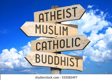 Wooden signpost with four arrows - Atheist, Muslim, Catholic, Buddhist - great for topics like religion etc.