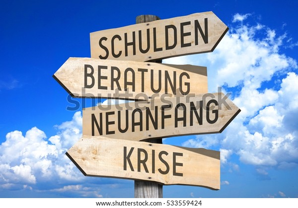 Wooden signpost with four arrows - Shulden, Beratung, Neuanfang, Krise - German/ debts, advice, new beginning, crisis - English, great for topics like bankruptcy, crisis etc.