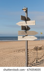 Wooden signpost on the shore of the North Sea.