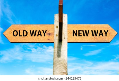Wooden signpost with two opposite arrows over clear blue sky, Old Way and New Way signs