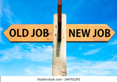 Wooden signpost with two opposite arrows over clear blue sky, Old Job and New Job, Career change conceptual image