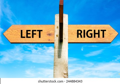 Wooden signpost with two opposite arrows over clear blue sky, Left versus Right messages, Choice conceptual image