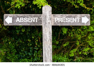 Wooden signpost with two opposite arrows over green leaves background. ABSENT versus PRESENT directional signs, Choice concept image