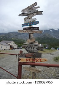 wooden signposts made by tourists from all over the world in different languages, on top of the mountain near the station of the rescue brigade. Khibiny, Murmansk region