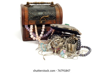 Wooden and silver old chests with pearls and gold , isolated on white