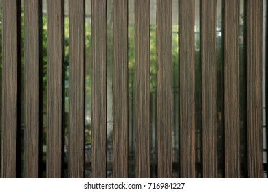 Wooden slats toppled over glass walls background.