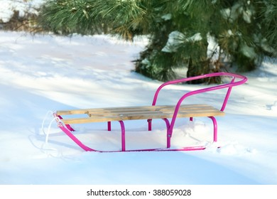 Wooden sled on snow, outdoor