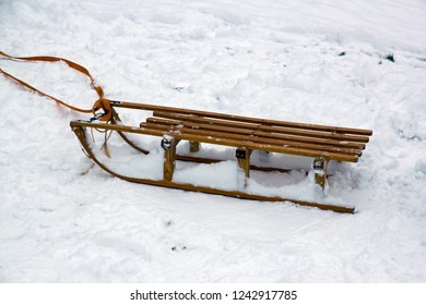 Wooden sled on the snow. A snowy winter.