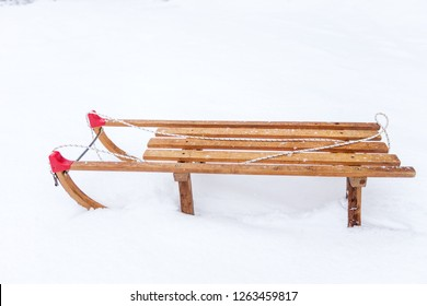 Wooden sledge in a snow