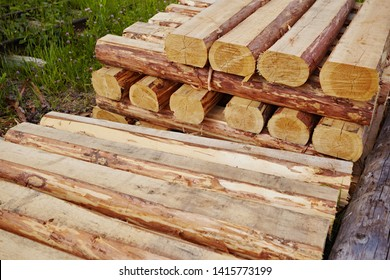 Wooden sleepers are new, folded into a group. Bars and logs
