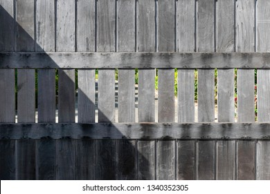 Wooden slide door of park with sunlight and shadow.