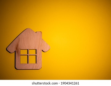 Wooden small house on the background. Sell and buy estate