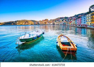 Wooden small old boats in Porto Santo Stefano seafront, italian travel destination. Monte Argentario, Tuscany, Italy.