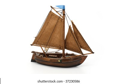 Wooden small ship isolated on white background