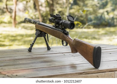 Wooden sniper rifle with scope and bipod