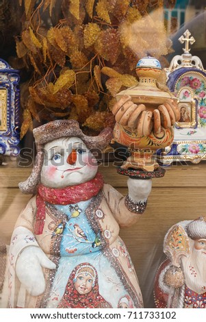 wooden snowman handicraft of a snowman made from wood for a vintage collectible on a
