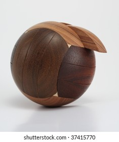Wooden sphere puzzle on white background