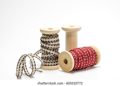 Wooden spools with ribbon