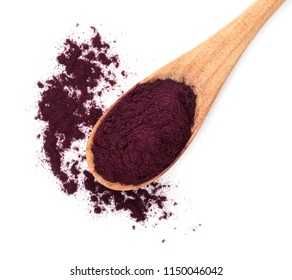 Wooden spoon with acai powder on white background, top view