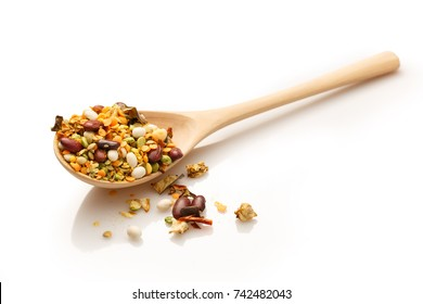 Wooden spoon with bean mixture on white