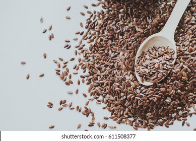 wooden spoon of brown flaxseed or linseed. Cereals. Vitamins. Healthy food.
