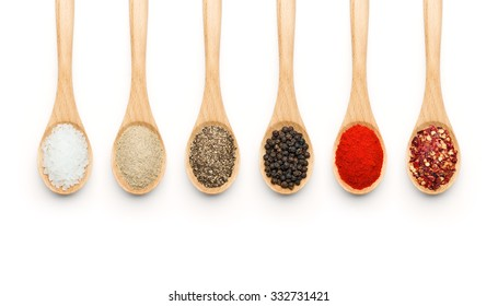 Wooden Spoon filled with various spices on white background