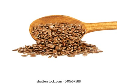 Wooden spoon with flax seeds isolated on white background