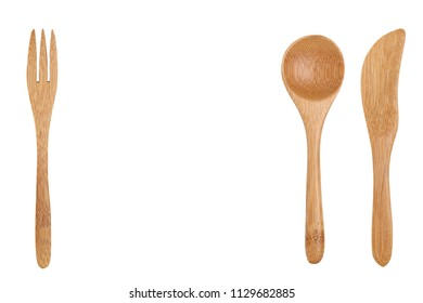 wooden spoon and fork, knife isolated on wood background