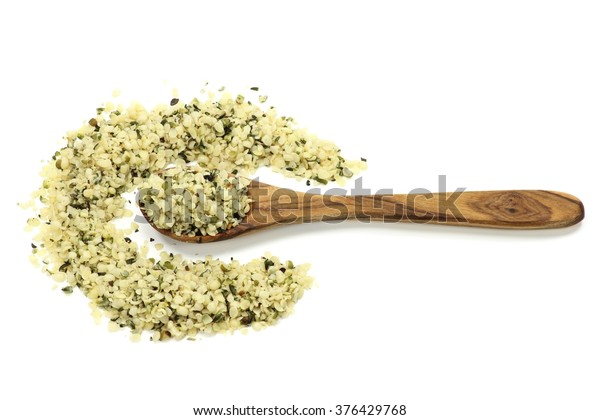wooden spoon with hemp seeds isolated on white background