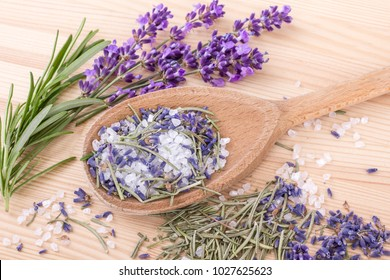 wooden spoon with Herb salt of rosemary and lavender blossoms