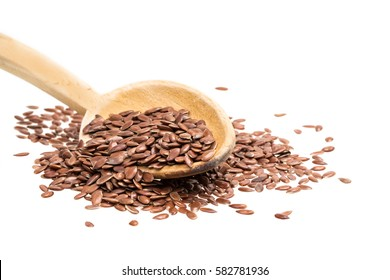 Wooden spoon with linseeds or flax seeds isolated on white