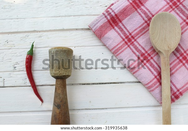 Wooden spoon, pestle and paprika