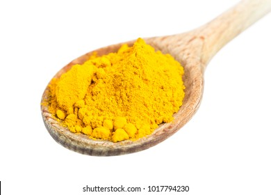 wooden spoon with yellow curry powder. real edible food, no artificial ingredients used!