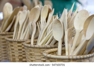 Wooden spoons in wooden baskets.