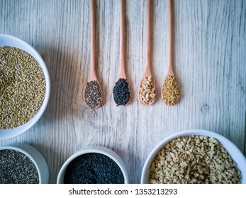 Wooden spoons with Chia, black sesame, soy, golden flaxseed