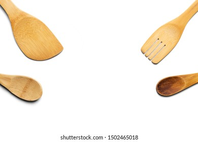 Wooden spoons, fork and stirrer. Isolated on white background. Top view.