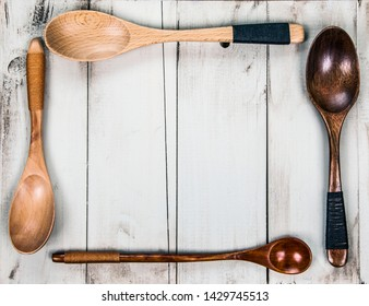 Wooden spoons on rustic, vintage, natural wood - food concept as a cooking and kitchen menu background, with design space.