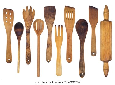 Wooden spoons, spatulas and a rolling pin isolated on white background